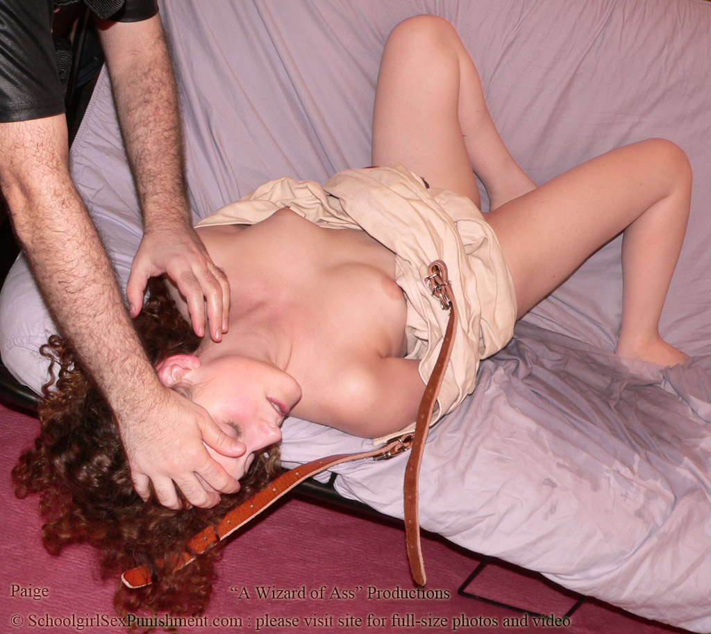 Paige, in straitjacket, just after spanking, enema and blowjob